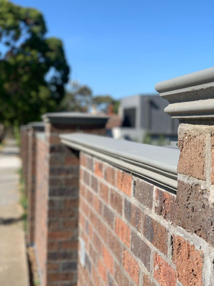 Solid brick fence with pier capping on a front fence Melbourne job by Bayside Brick Fences